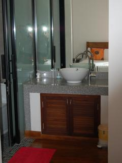 vanity unit , rear bedroom, both bedrooms / bathrooms are very pleasant and similar in size