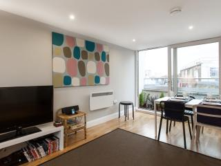 Living room with bright sunny window, generous seating, Sofa Bed, TV and WIFI