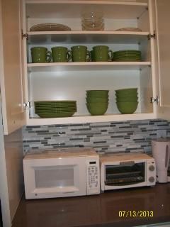 Fully stocked cabinets in kitchen
