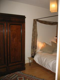 Bedroom with antic mahagony wardrobe