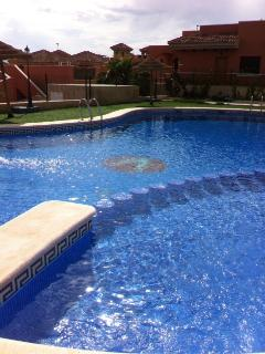 The swimming pool has a jacuzzi and childrens area