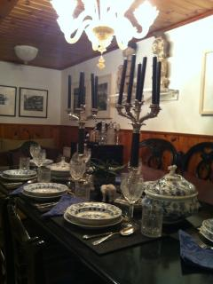 Table in the formal dining room set with our precious china