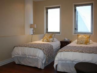 Spacious double bedroom with panoramic views of the city