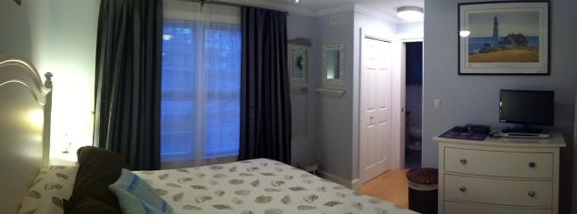 The first floor master bedroom has a flat screen TV, DVD player and a private bathroom with jacuzzi tub.