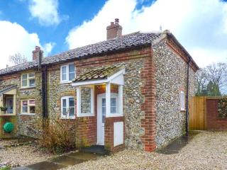 BROOM COTTAGE, character features, enclosed garden, WiFi, in East Rudham, Ref