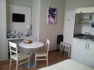 Bedroom 1 with kitchen corner