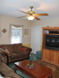 Front living room w/ tv & two comfy couches