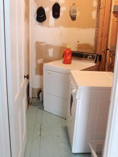 Washer and dryer off center sitting room