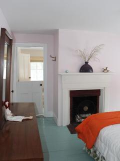 Center bedroom - view into front bedroom & barn door