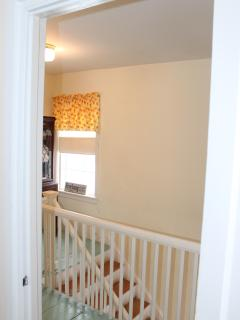Looking out front bedroom to upstairs landing