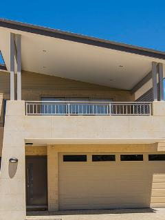 The front of this freshly constructed property is a stunning skillion elevation with stylish rammed earth as a feature...