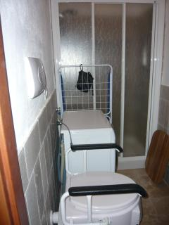 En suite bathroom, disabled wc, washing machine, shower with grip rails & folding shower seat