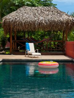 Refreshing infinity pool, lounge chairs and hammock ready to be enjoyed