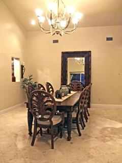 Formal Dining Room overlooking pool and wine room