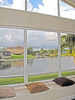Family room sitting area w/ large picture windows overlooking Basin Waterfront