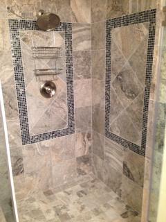 Luxurious Master Shower with rain head and beautiful glass tile inlay