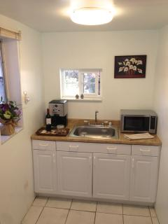 Kitchenette with microwave oven & coffee maker