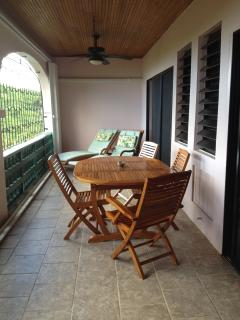 thirty foot gallery with teak furniture and view of the Caribbean