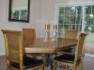 Spacious dining room with lots of great beach theme plates, flatware and more