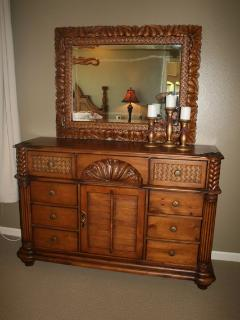 Beautiful carved Hawaiian furnishings in master suite