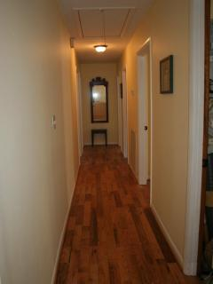 hall leads to 4 spacious bedrooms, 2 full baths and laundry room