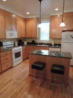 The gourmet kitchen features granite counters, gas cooking, & plenty of kitchen equipment!