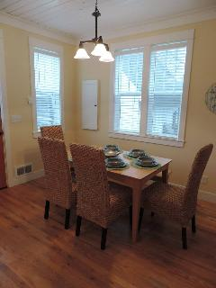 The dining room is open to the kitchen and seats six at the table and two more at the Island
