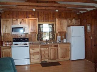 Kitchen with full size stove and fridge.