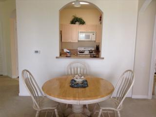 Dining area showing nook into kitchen
