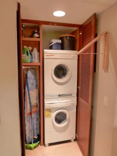 Bosch laundry center, ironing board, folding hanger rack for clothes that can't be put in the dryer.