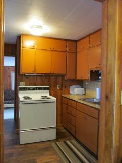 Fully stocked kitchen with stove, fridge, microwave, cookware, dishes, flatware, griddle, & crockpot