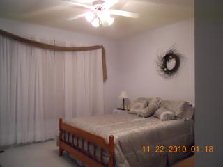 Master bedroom with bath and access to deck.