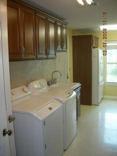 Laundry room with large size washer and dryer