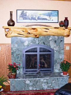 Granite fireplace with juniper log mantle