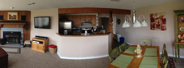 Panoramic View of Family Room, Dining Room and Kitchen
