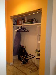 closet with beach chairs, iron & ironing board