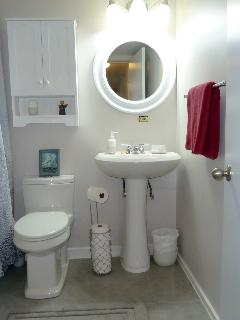 Clean four piece bathroom with fluffy towels, shower and tub