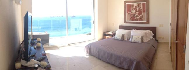 One master bed suite ocean view with a terrace balcony.