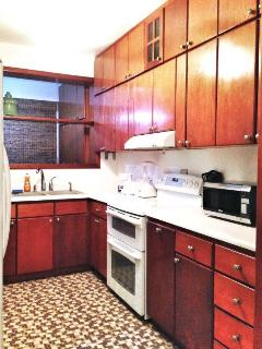 The fully-equipped kitchen has a laundry area with washer and dryer.