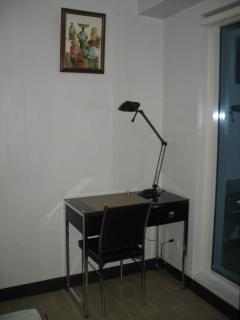 Bedroom: Work table with reading lamp in one corner