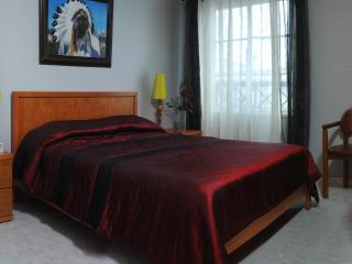 large confortable double bed room next to the bathroom
