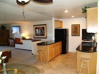Kitchen leads to Living Room