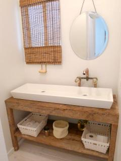 Designed by BerchtoldHarris Build+Design Firm Reclaimed wood vanity with extra long sink