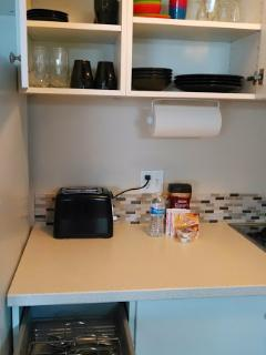 Cupboards with a matching set of dishes for four.  Kids dishes as well.