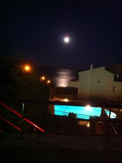 Nightime with the moon over water