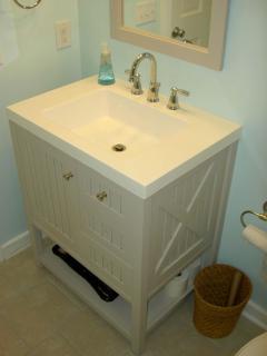 Martha Stewart vanity in full bathroom on main level. Ceramic floor tile.
