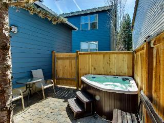 Second story loft with enclosed patio and private hot tub - close to town!
