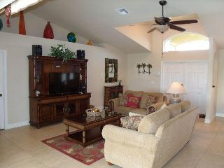 Great Room opens to front lanai and enclosed pool/lanai/canal