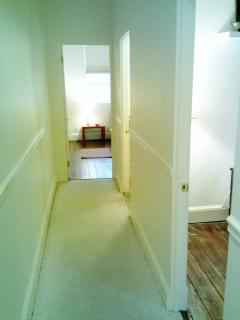 The hallway on the 2nd floor leads from the full bedroom (on the right) to the Queen bedroom at the end.