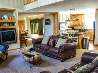 Living area opens into the kitchen and dining area.Great fireplace and modern comforts